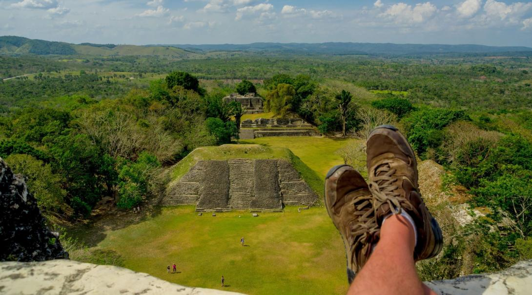 A traveller takes a break after reaching the top of the Xunantunich Mayan Ruins in Belize.